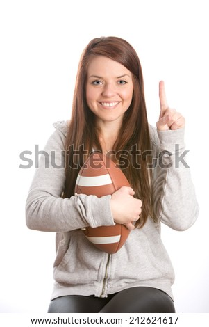 Female Football Fan - This is an image of a cute female football fan who is happy that her team just won the game. Shot on an isolated white background. - stock photo