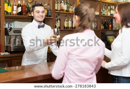 female friends chatting and drinking wine in bar - stock photo