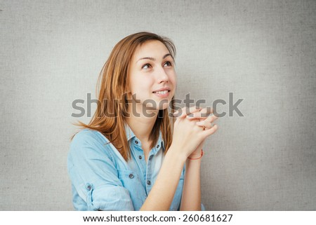 female gesture prayer, conversation with God. isolated on gray background - stock photo
