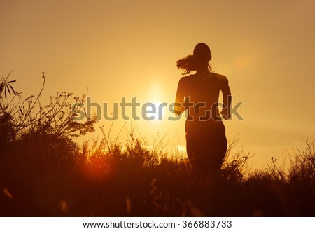 Female going for a early morning run.  - stock photo