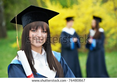 female graduation student in the park cheerful and happy - stock photo
