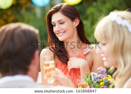 Female Guest At Wedding Reception - stock photo