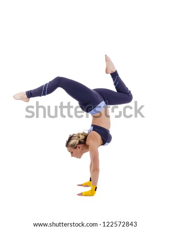 Female gymnast doing stagged out hand stand - stock photo