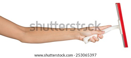 Female hand, bare, holding squeegee, isolated over white background - stock photo