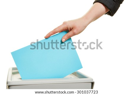 Female hand casting vote at election with ballot paper at box - stock photo