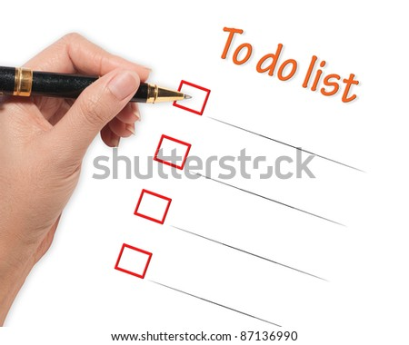 female hand checking to do list - stock photo