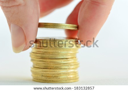 Female hand counting and stacking gold coins isolated on white background. Concept photo of bank, money, banking, finance, economy,goal,  saving and loans (Isolated on white background) Horizontal - stock photo