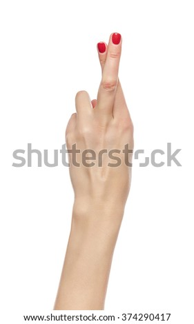 Female hand fingers crossed isolated on white background. - stock photo