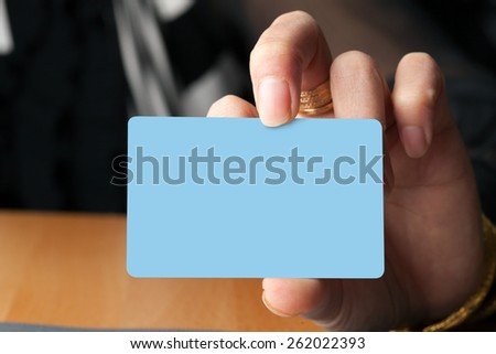 Female hand holding a blank business card gift card or credit card.  Plenty of copyspace for your logo or design. - stock photo