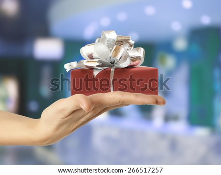 Female hand holding a gift box - stock photo