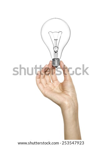 Female hand holding a light bulb, over white background - stock photo