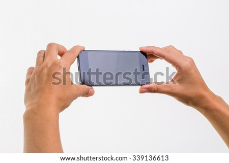Female hand holding a smart phone, isolated on white - stock photo