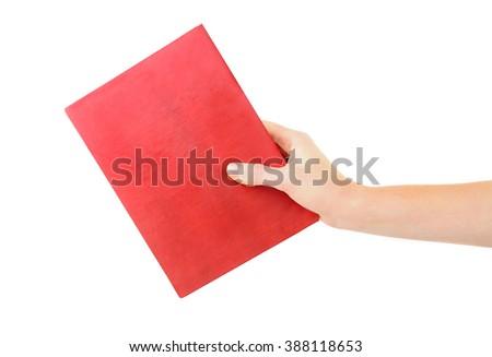 Female hand holding book, isolated on white - stock photo
