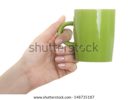 Female hand holding coffee mug on white - stock photo