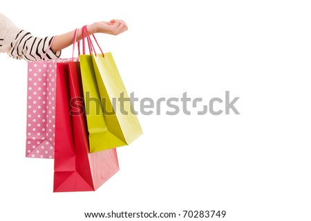 Female hand holding colorful shopping bags - stock photo