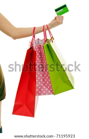Female hand holding colorful shopping bags and credit card - stock photo