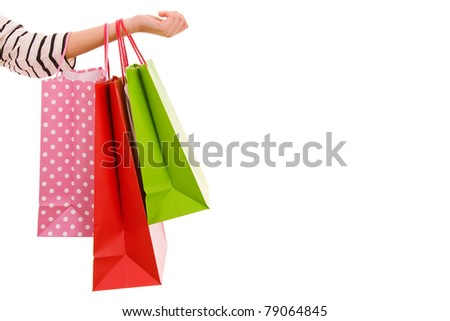 Female hand holding colorful shopping bags, isolated over white background - stock photo