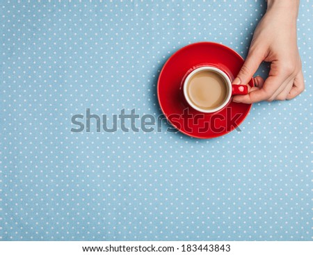 Female hand holding cup of coffee. - stock photo