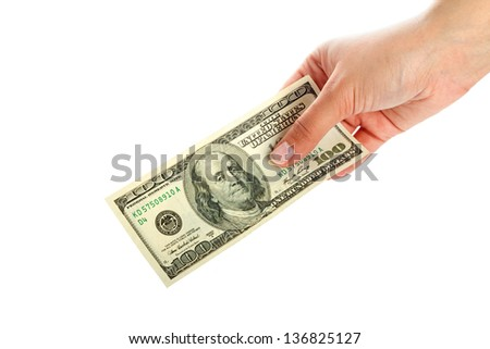Female hand holding 100 dollar banknote - stock photo