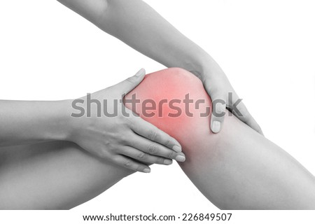 Female hand holding knee isolated on white background. Knee injury, muscle strain, sport injury. - stock photo