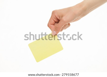 Female hand holding one yellow paper card, white background - stock photo