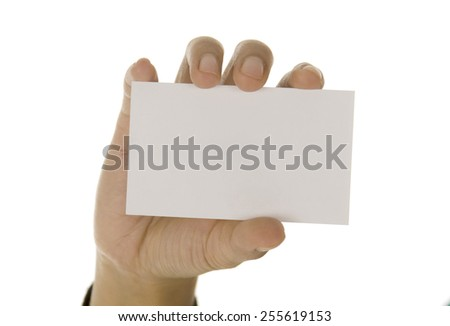 Female hand holding paper card, isolated on white background  - stock photo