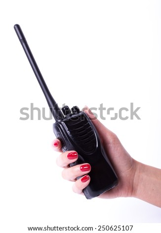 Female hand holding portable radio transmitter, isolated over white background - stock photo