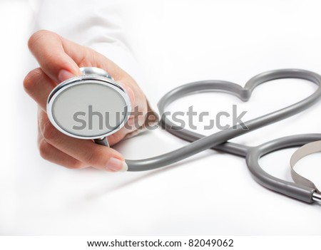 Female hand holding stethoscope; health care concept - stock photo
