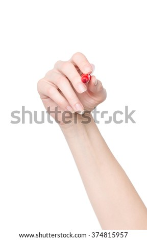 Female hand is ready for drawing with red marker - stock photo