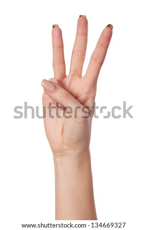 Female hand is showing three fingers isolated on white background - stock photo