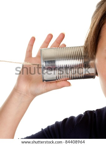 Female hand making a phone call through a can and wire - stock photo