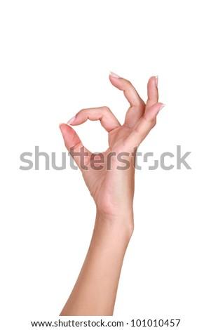 Female hand making an OK gesture - stock photo