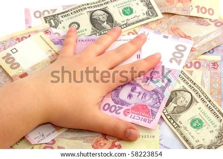 Female hand on monetary denominations - stock photo