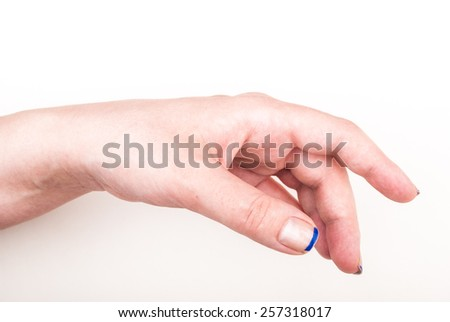 Female hand on white in a relaxed gesture - stock photo