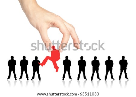 Female hand picking a chosen person from a group - stock photo