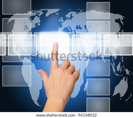 female hand pushing a button on a touch screen interface over world map - stock photo