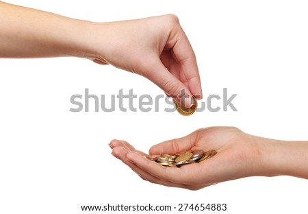 Female hand putting coin into another hand isolated on white - stock photo