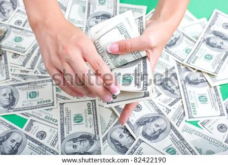 female hand recount money - stock photo