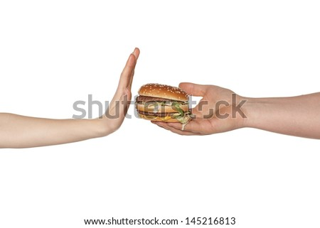 Female hand refusing the fast food meal - stock photo