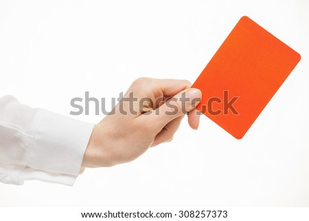 Female hand showing a red card, white background - stock photo