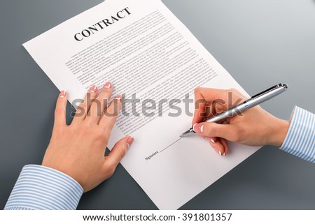 Female hand signs cooperation contract. Lady signing cooperation contract. We will become stronger. Never doubt and never hesitate. - stock photo