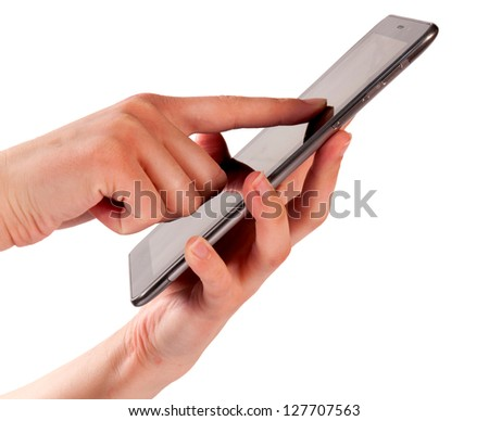 Female hand touching tablet isolated on white - stock photo