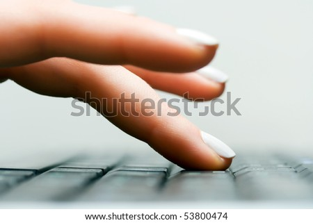 Female hand typing on computer keyboard. - stock photo