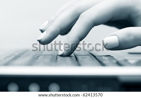 Female hand typing on the computer keyboard. - stock photo