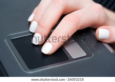 Female hand using touchpad. - stock photo