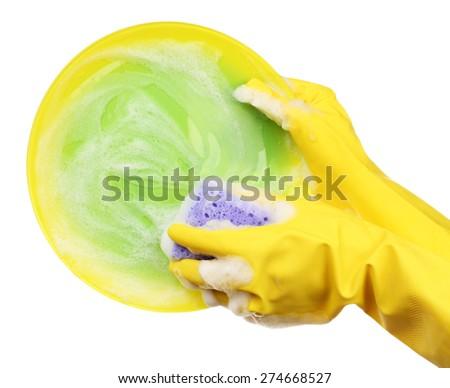 Female hand washing dish isolated on white - stock photo