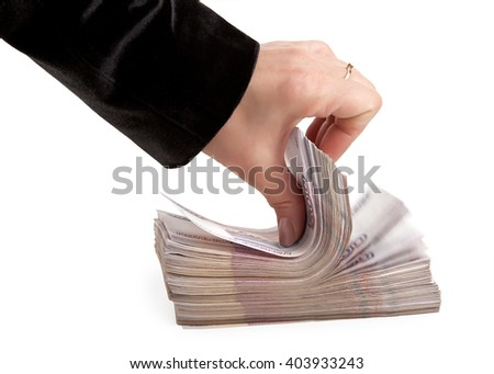 Female hand with a bundle of Russian paper money - stock photo