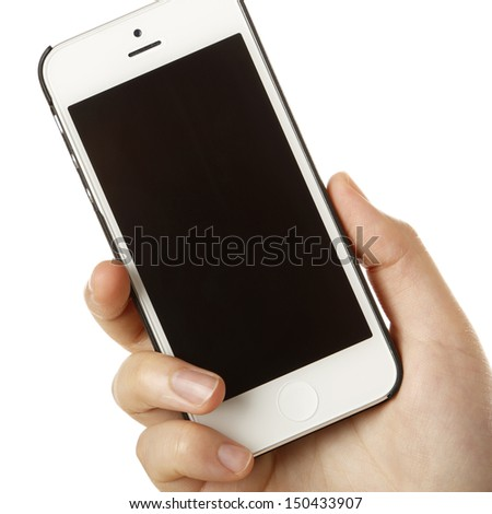 Female hand with a smartphone on white background - stock photo