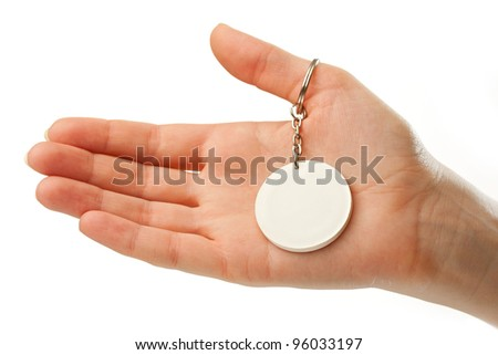 Female hand with blank badge - stock photo