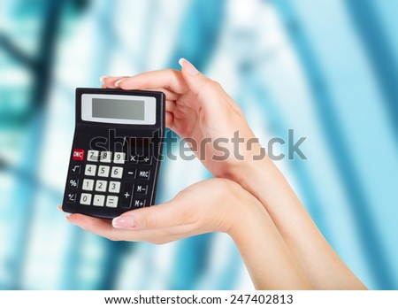 female hand with calculator  - stock photo